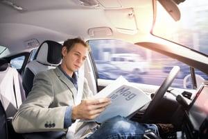 Man sitting in self-driving car