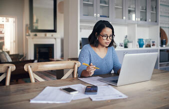 A woman at a desk, working from home